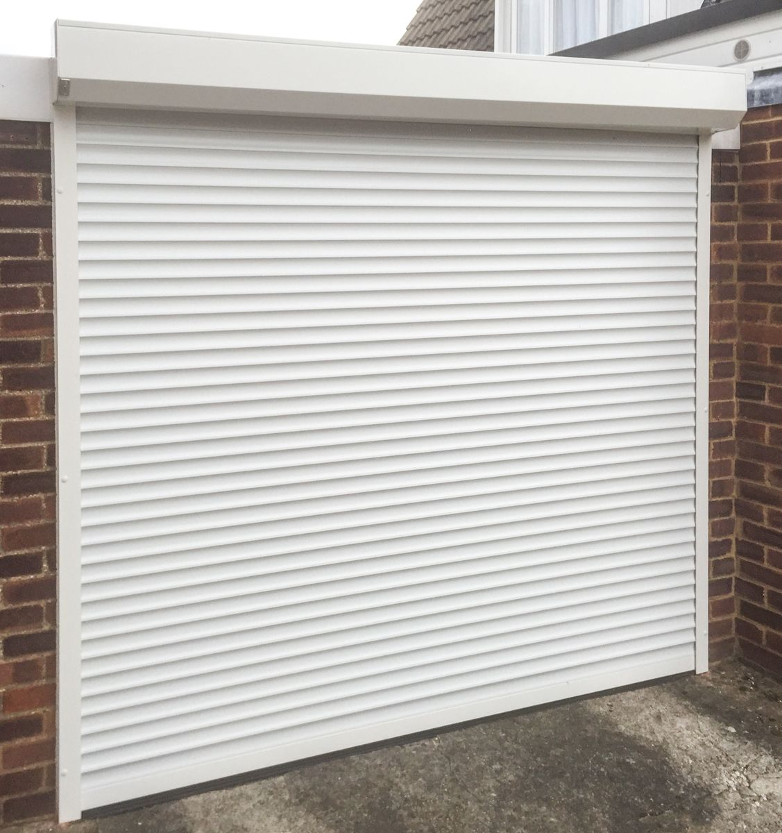 An SWS SeceuroGlide Roller Garage Door finished in White