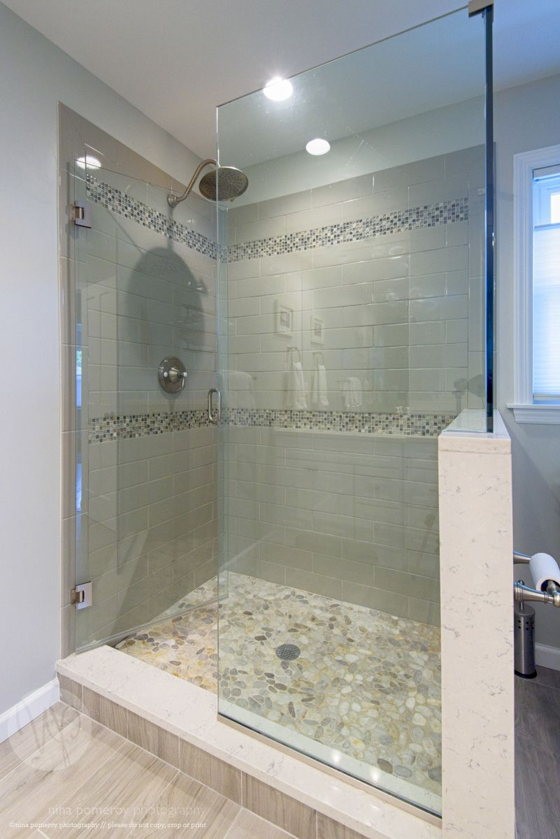 Glass shower stall river rocks frameless glass shower for Tiled bathroom designs pictures