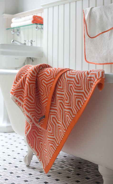 Old White Clawfoot Tub And A Modern Orange Bath Towel Great