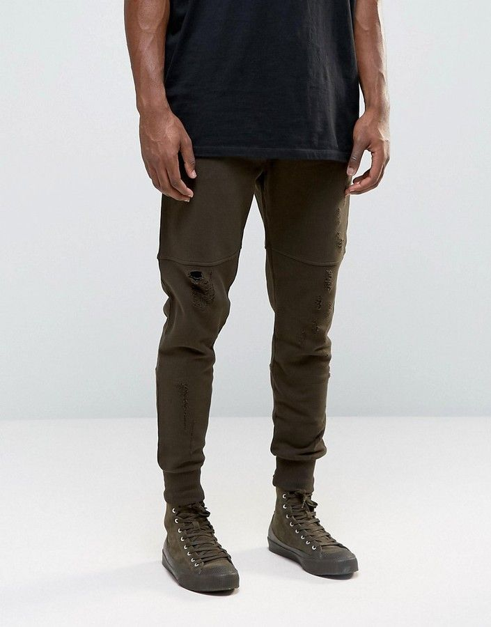 newest c0586 adc39 Asos Tapered Joggers with Rips and Zip Pockets In Brown