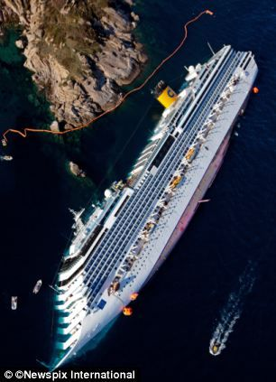 Stranded: Aerial view of the the Costa Concordia in Isola del Giglio, Italy. This is eerie.