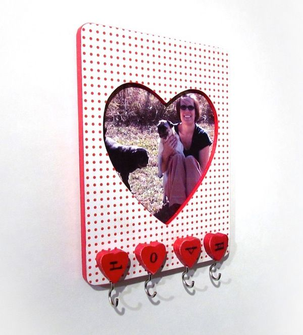This project was so cheap to make! Turn a $1 heart frame into a keyholder using basic supplies and Mod Podge. Such a cute organization idea.