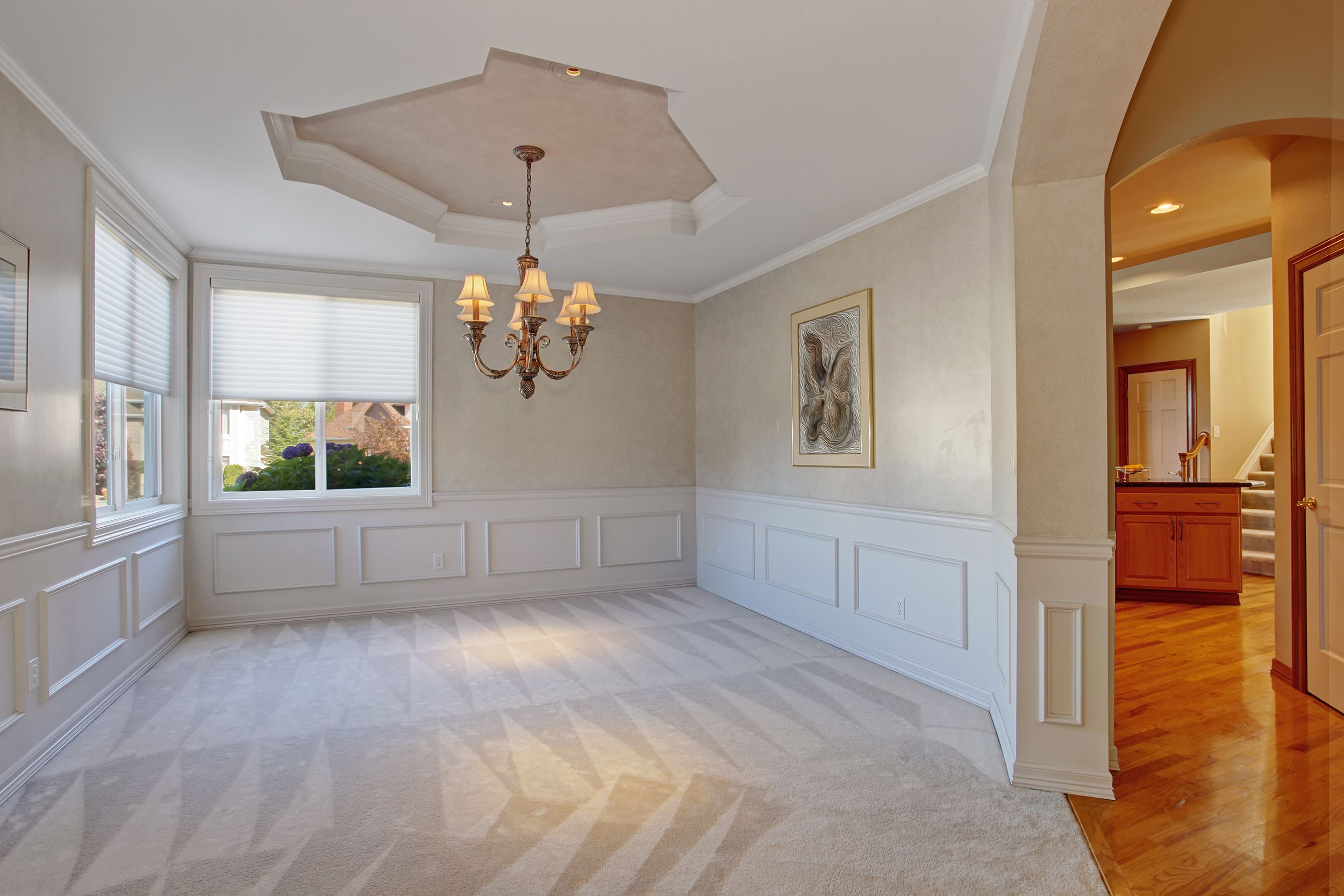LAYER SIMILAR SHADES Make a room appear larger by putting ...