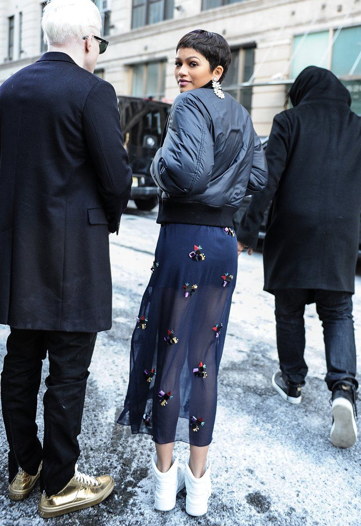 Pin for Later: She May Only Be 19, but Zendaya Is Already a Style Icon  Despite the cold, Zendaya paired a sheer embellished skirt with sneakers and a jacket during NYFW.