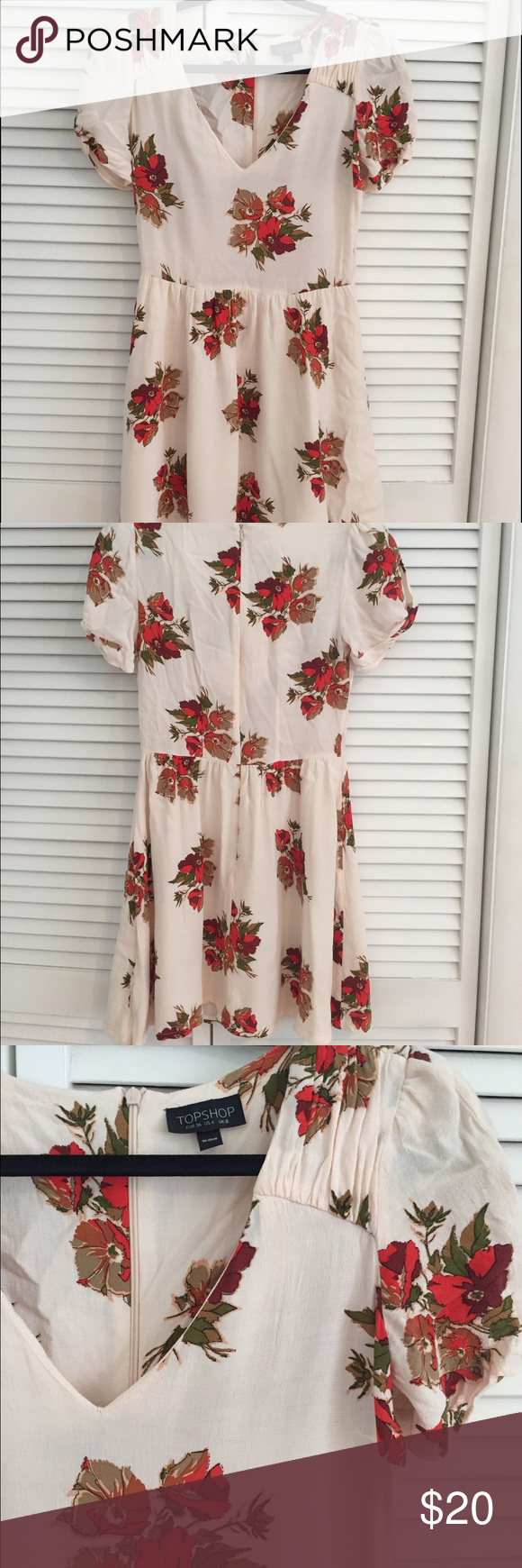 TopShop floral dress This dress is great in fall and has such a classic feminine flare. Key hole twist detail on the sleeves, v neck, zip back, fitted waist, flowy skirt. Shoulder to waist: 15.5in, skirt length: 17in, shoulder to bottom: 32in Topshop Dresses Mini