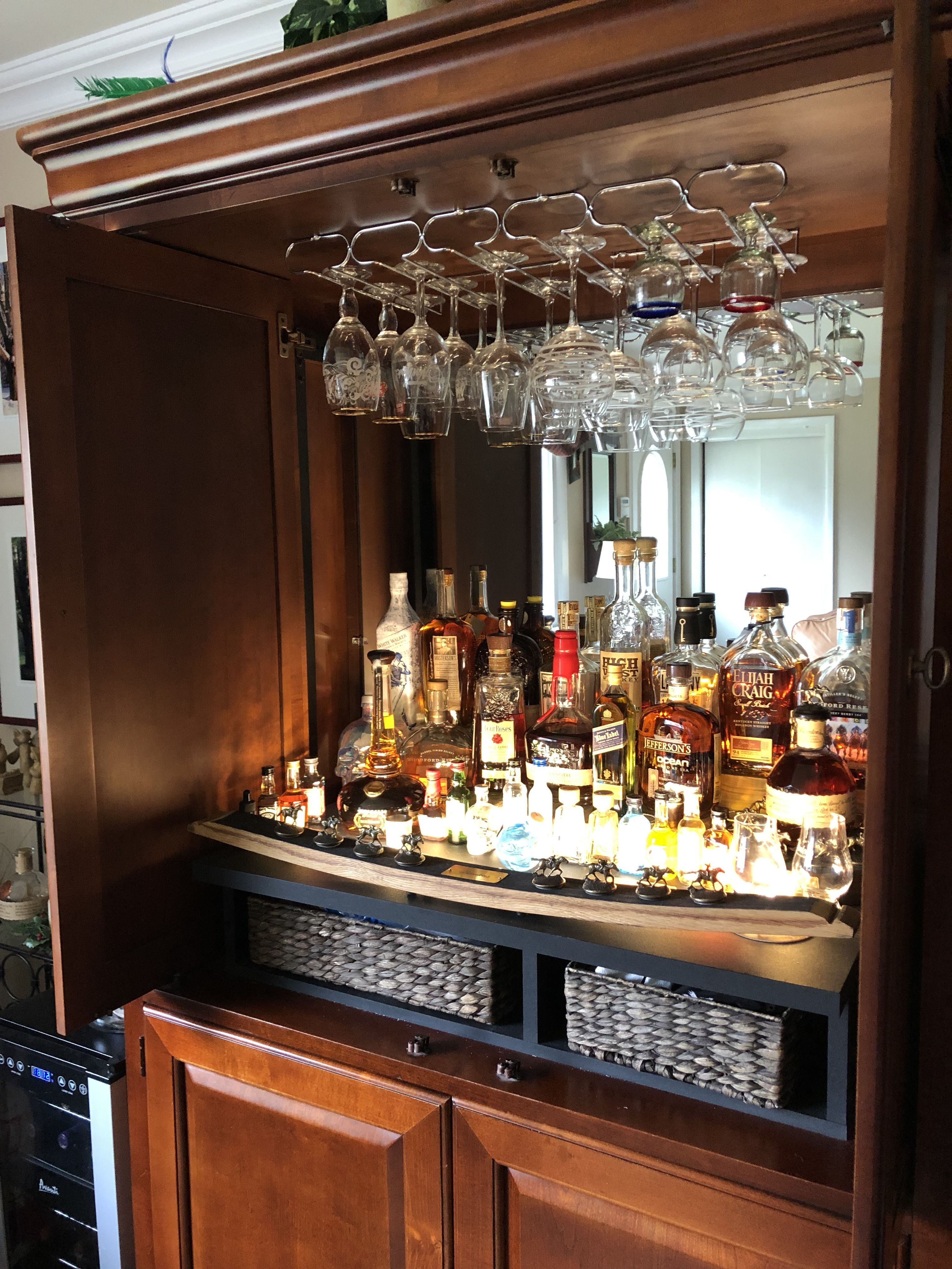 Originally a TV armoire; we've repurposed it to be a bar ...