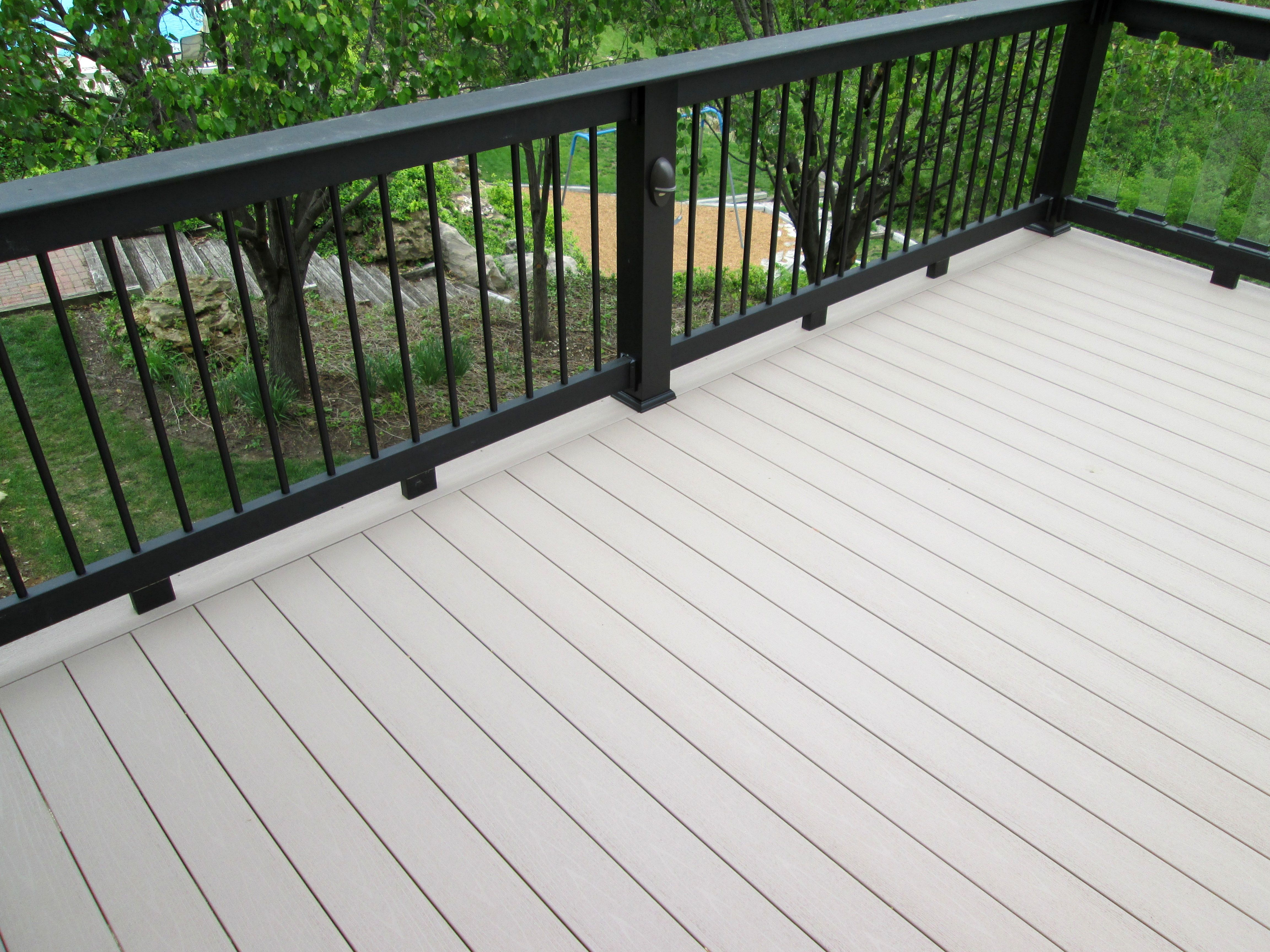 These Homeowners Chose Timbertech Terrain Decking And Evolutions Railing The Project Was Designed Wi Deck Designs Backyard Decks Backyard Outdoor Living Deck