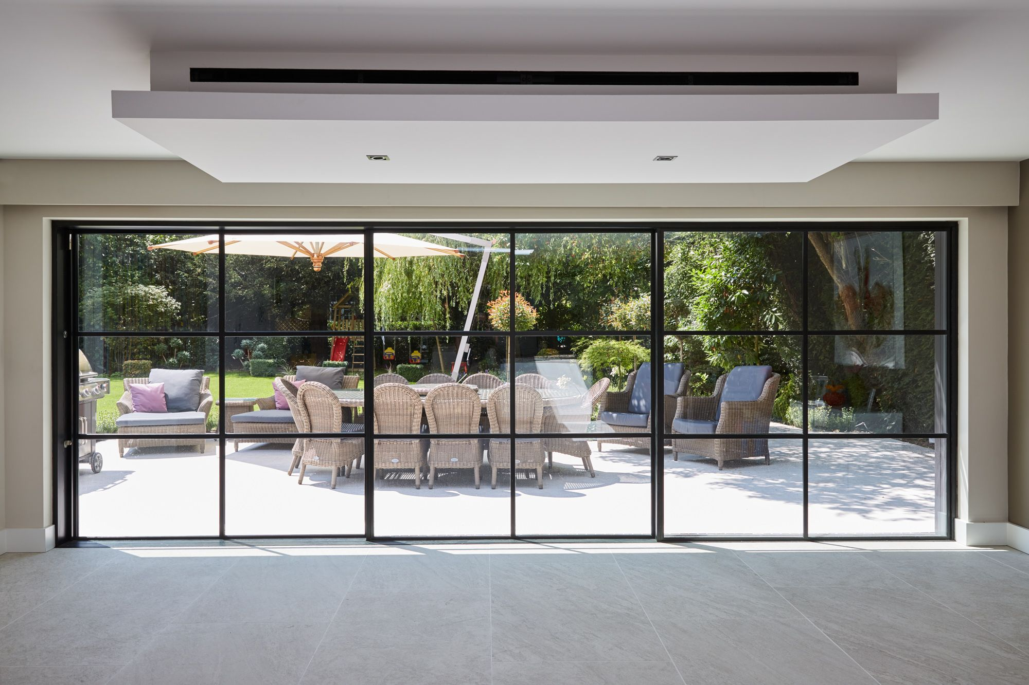 Internal Shot Of Triple Track Minimal Frame Sliding Doors In The Closed Position With Crittal Style Steel F External Sliding Doors External Doors Sliding Doors