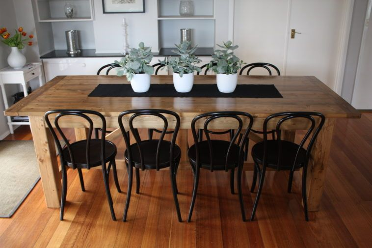 Brown Solid Wood Table With Black Iron Chair Placed On Brown Laminated Wooden Floor With Rest Dining Table Black Wooden Dining Tables Comfortable Dining Chairs