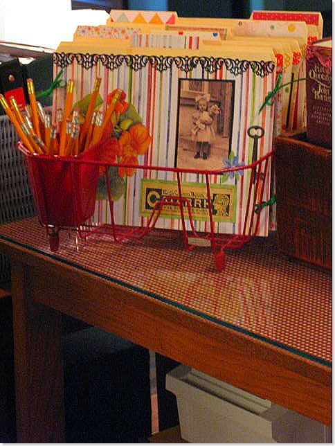 Seriously?  A dish rack will hold file folders?  Brilliant!! Love the utensil holder for pencils.  Too perfect.