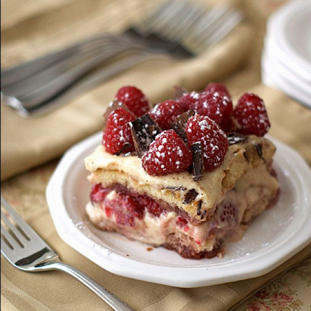 Peanut butter and jelly tiramisu! Cream cheese/whipped peanut butter layered with lady fingers, raspberry jam, and fresh raspberries.