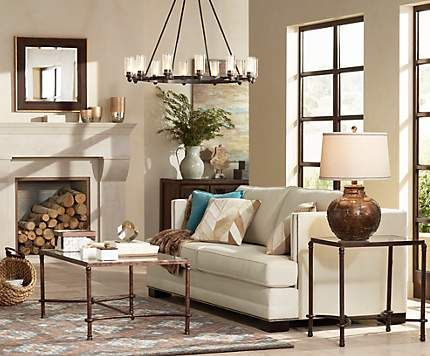 A large chandelier anchors a cozy living room with rustic touches ...
