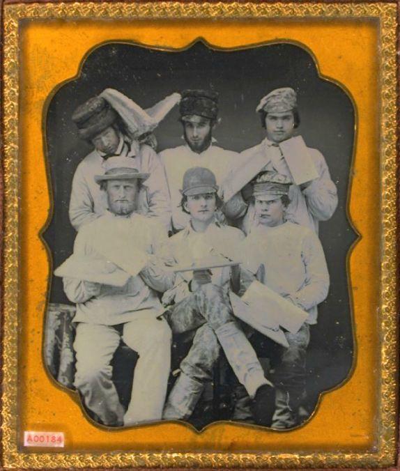 daguerreotype group portrait of plasterers wearing hats, caps, holding palettes, hod, trowels