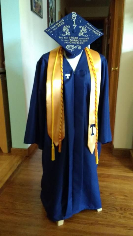 Graduation Cap And Gown Displayed On Half Mannequin And