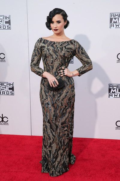 Demi Lovato looked classic and chic in a printed floor-length dress and went for Old Hollywood Glamour with her retro waves and vampy lip.  Sign Up for Our Newsletter