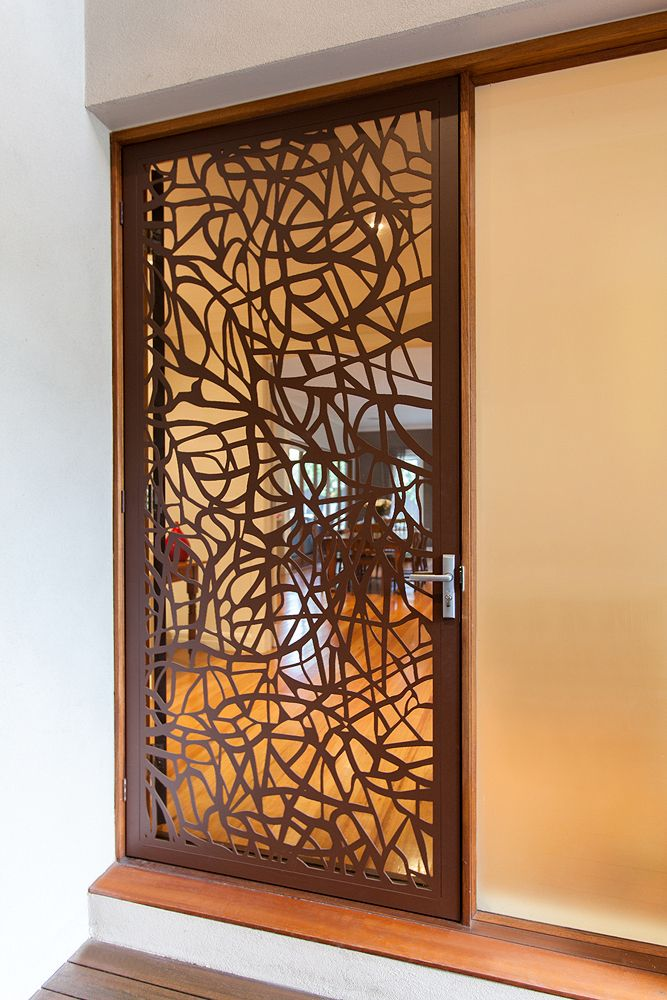 Laser cut architectural screen door that blends into the for Door design cnc