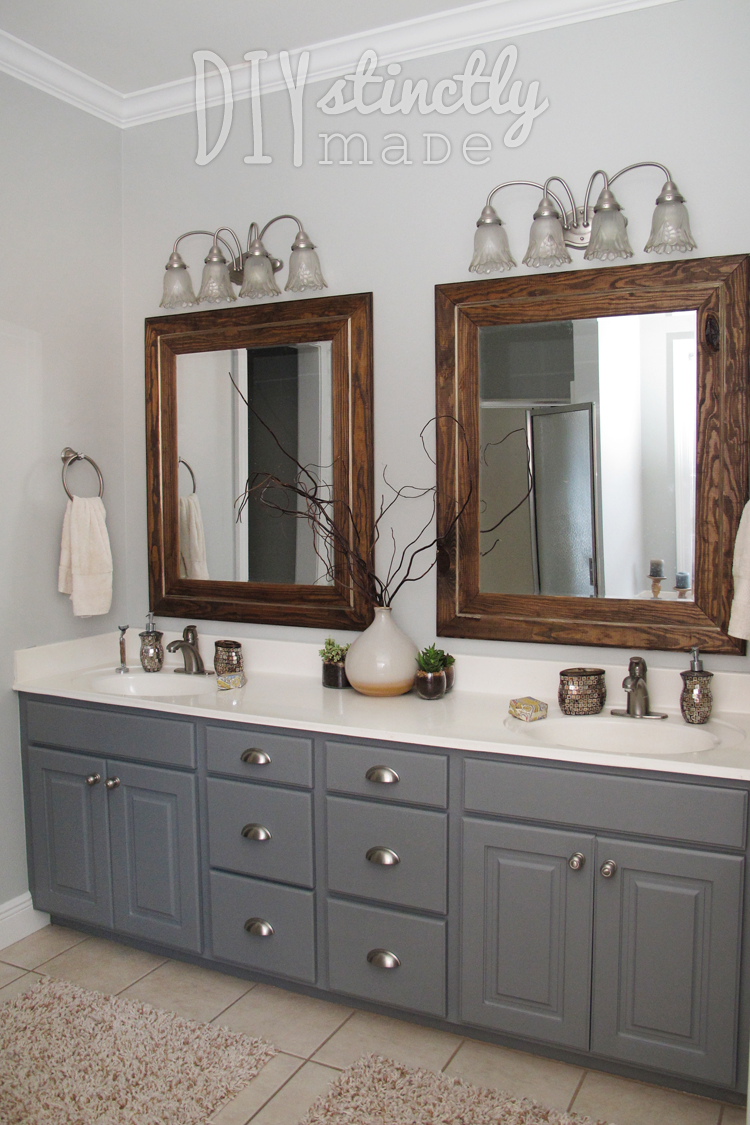 Grey Cabinets, Wood Mirrors, And Light Countertops