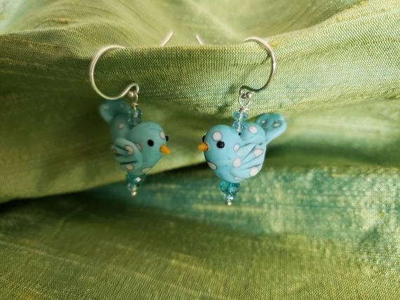 Photo of Songbird Earrings are pert little dotted blue birds on Argentium silver French earwires; and embelli