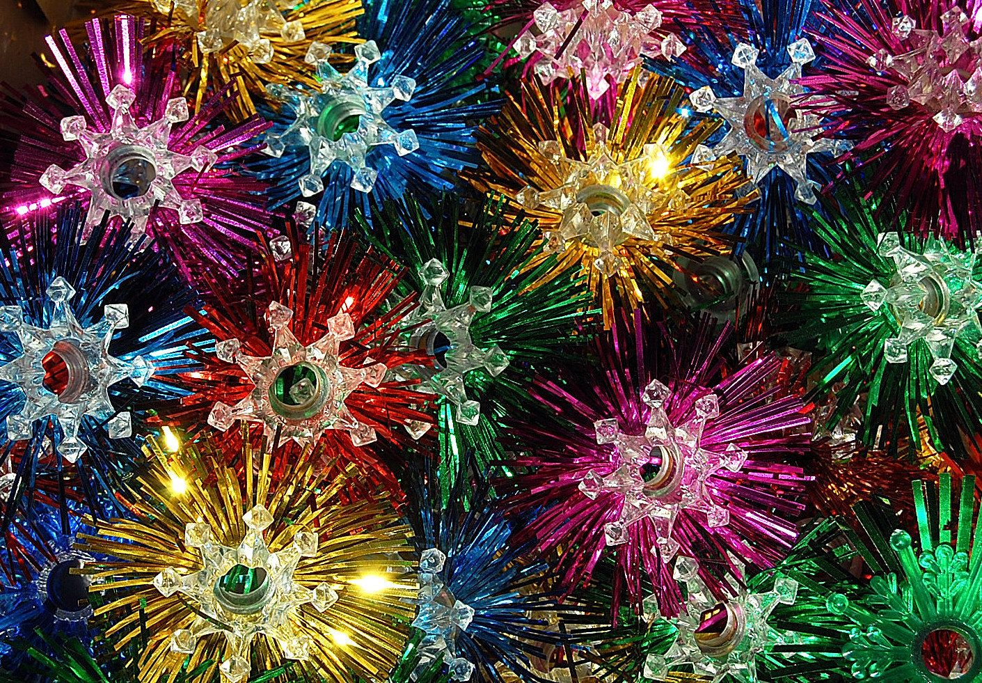 vintage retro christmas light reflectors made of plastic and tinsel starbursts
