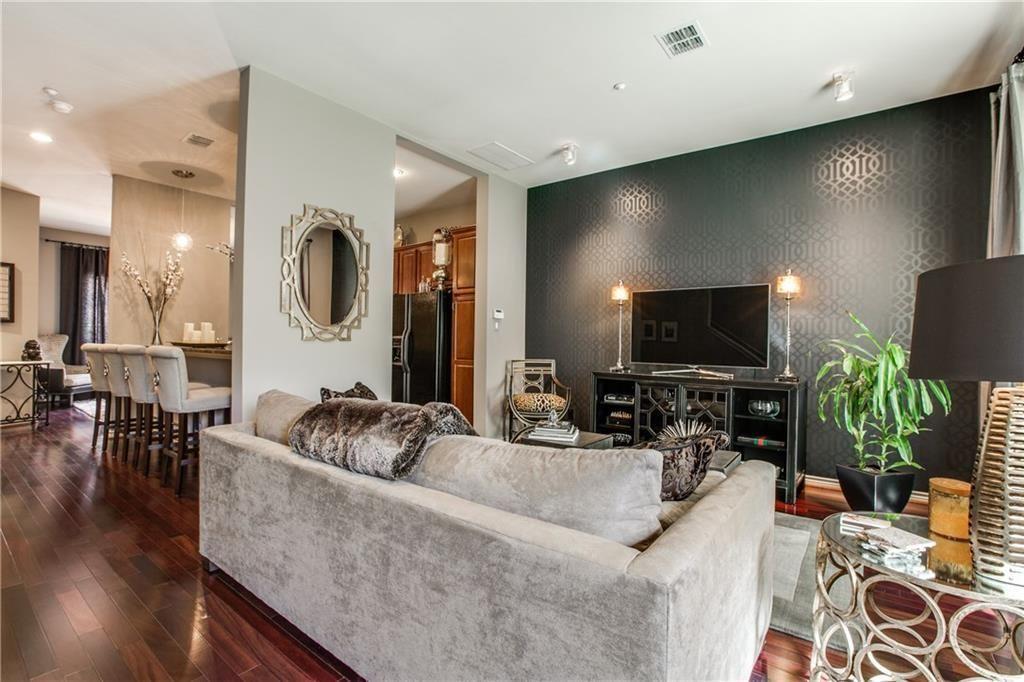 Art Deco Living Room with Hardwood floors, High ceiling, Carpet, flush light…