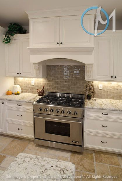 Colonial gold with white cabinets presents a very clean for Brushed aluminum kitchen cabinets