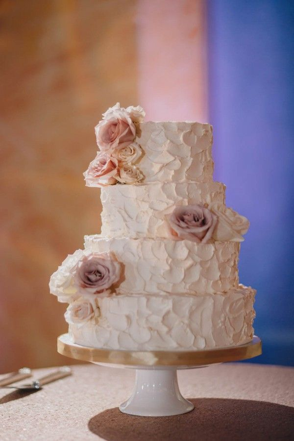Classic white wedding cake | Photo by Gabe McClintock via http://junebugweddings.com/wedding-blog/glamorous-wedding-fairmont-banff-springs-hotel/