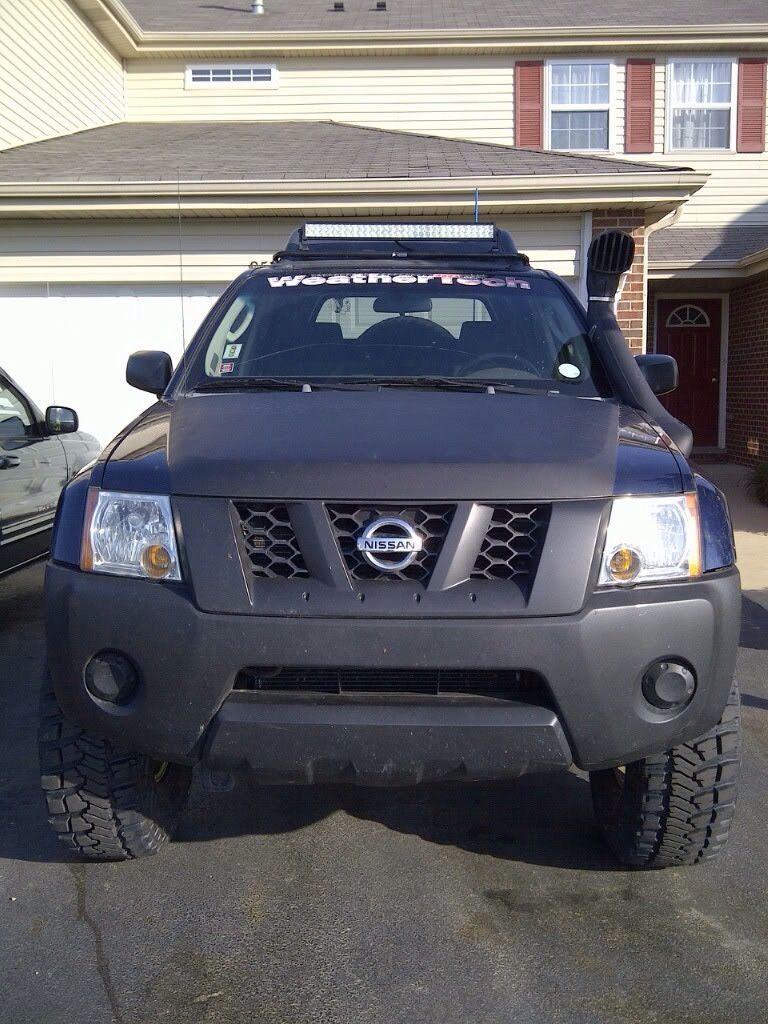 21 performance series light bar on the roof of a nissan xterra