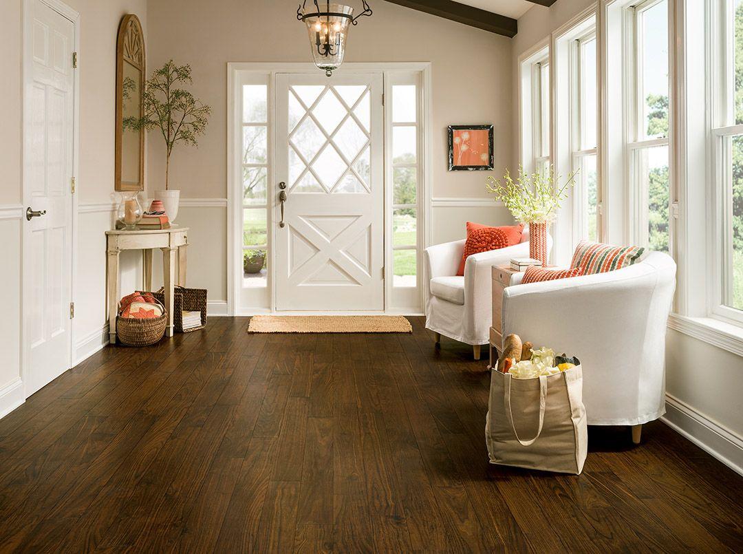 Rich brown wood plank flooring Luxury Vinyl LVP