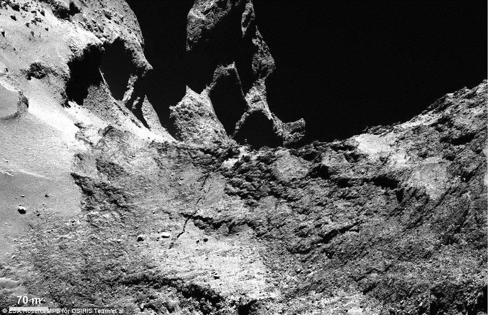 This Osiris narrow-angle camera image shows part of a large fracture running across Comet ...