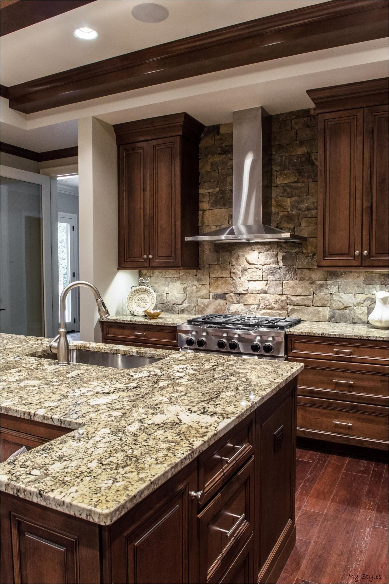 Aug 15 2015 Custom Wood Cabinets And Gray Stone Countertops Are Top Of The Li Dark Wood Kitchen Cabinets Brown Kitchen Cabinets Granite Countertops Kitchen