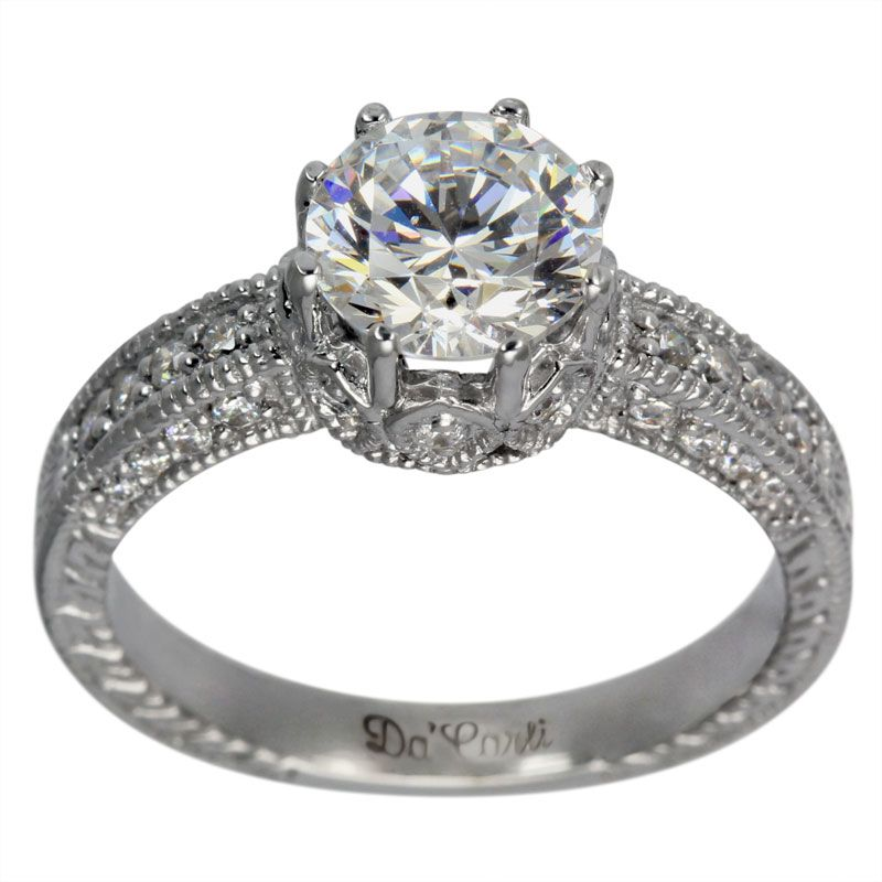 Vintage Filigree 8 Prong Pave Diamond Engagement Setting -  This vintage engagement setting can accommodate between a 0.90ct and a 1.25ct center diamond.     This ring is adorned with brilliant round accent diamonds which enhance the center diamond.   The milgrain and engraving give it the unmistakable appearance of antique rings.      The characteristics of these rings are milgrain, engraving and scrollwork. Our rings have thick and durable shanks which will give many years of…