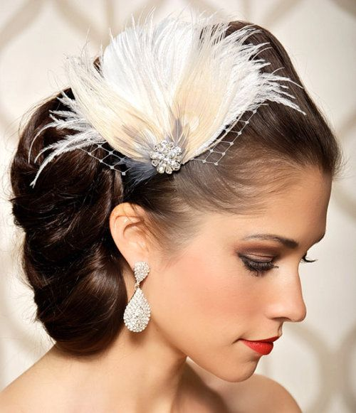 updo with feather hair piece