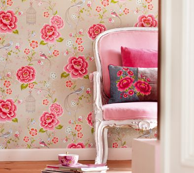 Vibrant rose floral and bird cage wallpaper with pink upholstered chair ~ Rose cottage. For girls room