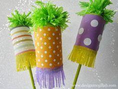 DIY Pom-Pom Purim Groggers - http://www.studioaflo.com/others/diy-pom-pom-purim-groggers/