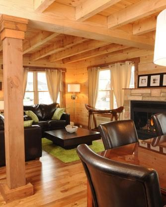 Contemporary suburban log home living room with lime green and brown leather furnishings