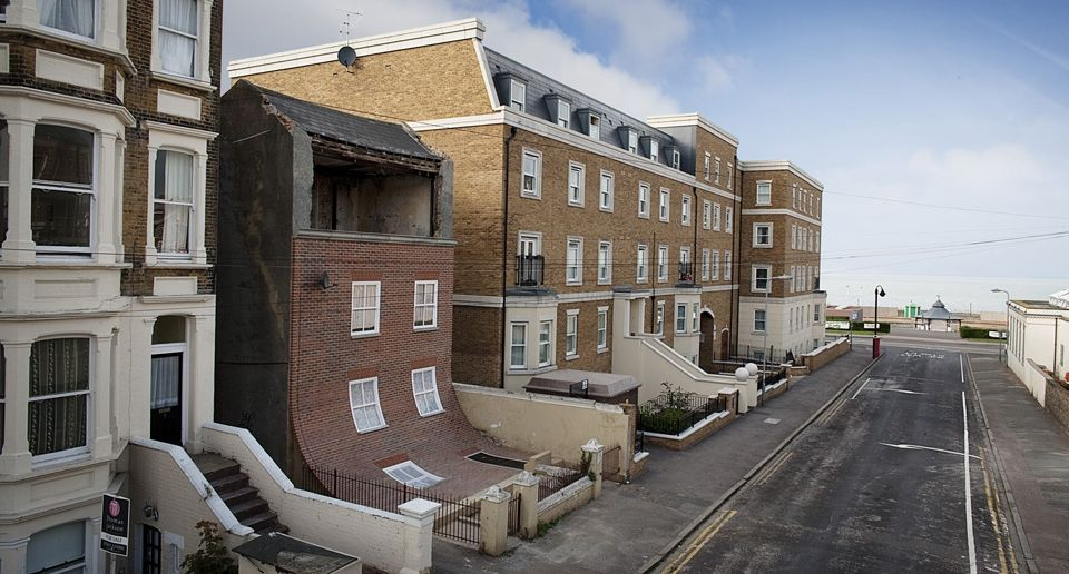"""From The Knees Of My Nose To The Belly Of My Toes,"" London-based artist Alex Chinneck reconstructed the facade of this abandoned four-level house in South East England to make it seem as though it's sliding down the rest of the building like a limp poster."