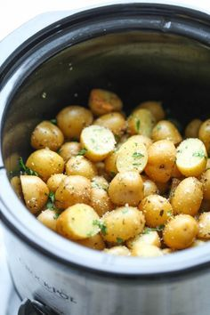 Slow Cooker Garlic Parmesan Potatoes - Crisp-tender potatoes with garlicky parmesan goodness. It's the easiest side dish you will ever make in the crockpot! Gluten free can be dairy free
