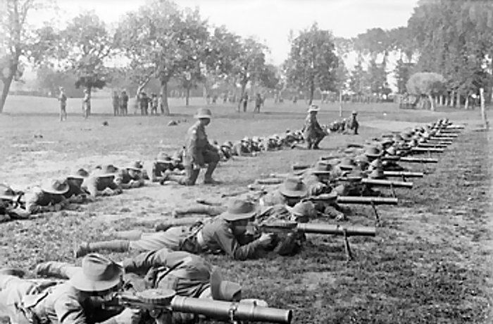 The Third Battle of Ypres (Passchendaele) 31 July - 10 November 1917. Men of 28th Battalion of the 2nd Australian Division lying stretched on the ground to practice Lewis gun drill at Renescure