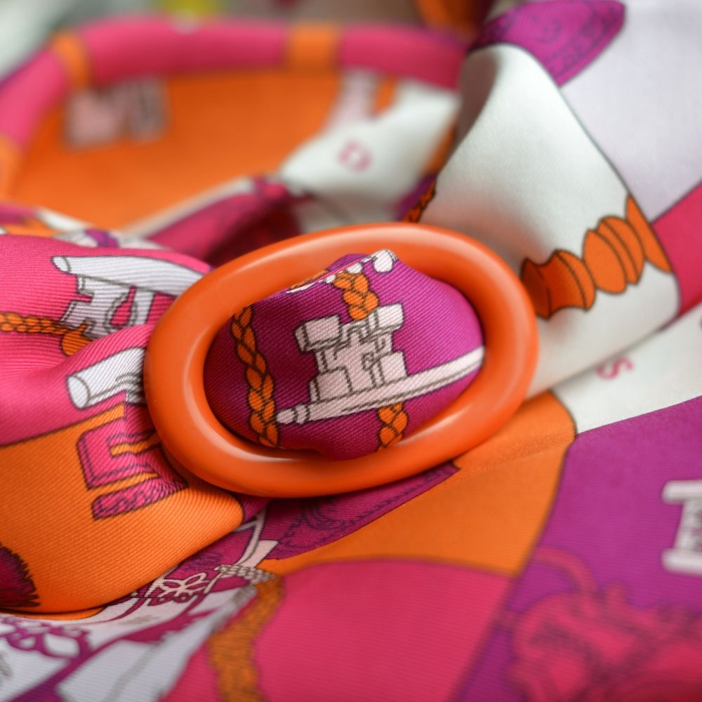 Lacquered MaiTai Collection scarf ring in orange with Hermes 'Tours de Clès' 70 scarf
