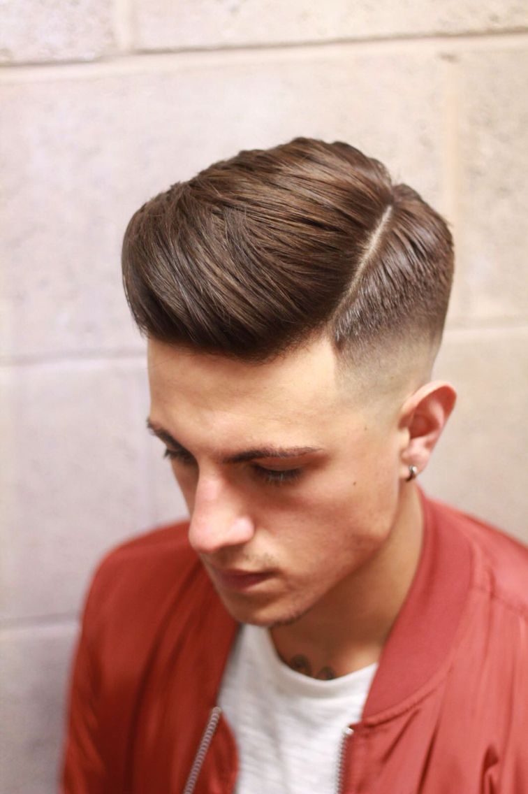 high drop fade with undercut side parting and sweep over on