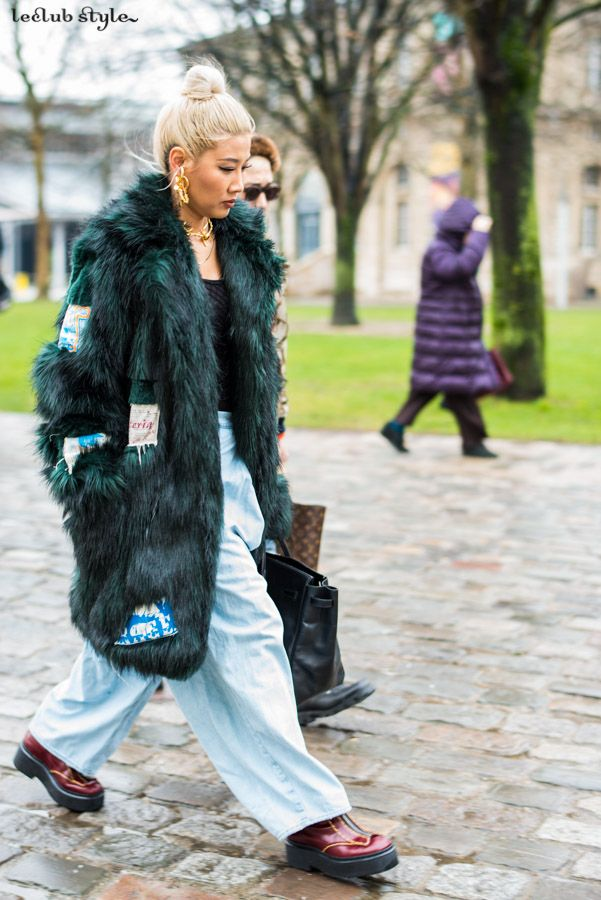 2ddb05b54dea Yoon Ambush wearing a faux-fur coat and oversized jeans before Kenzo show  by Ángel Robles. Fashion Photography from Paris Fashion Week.