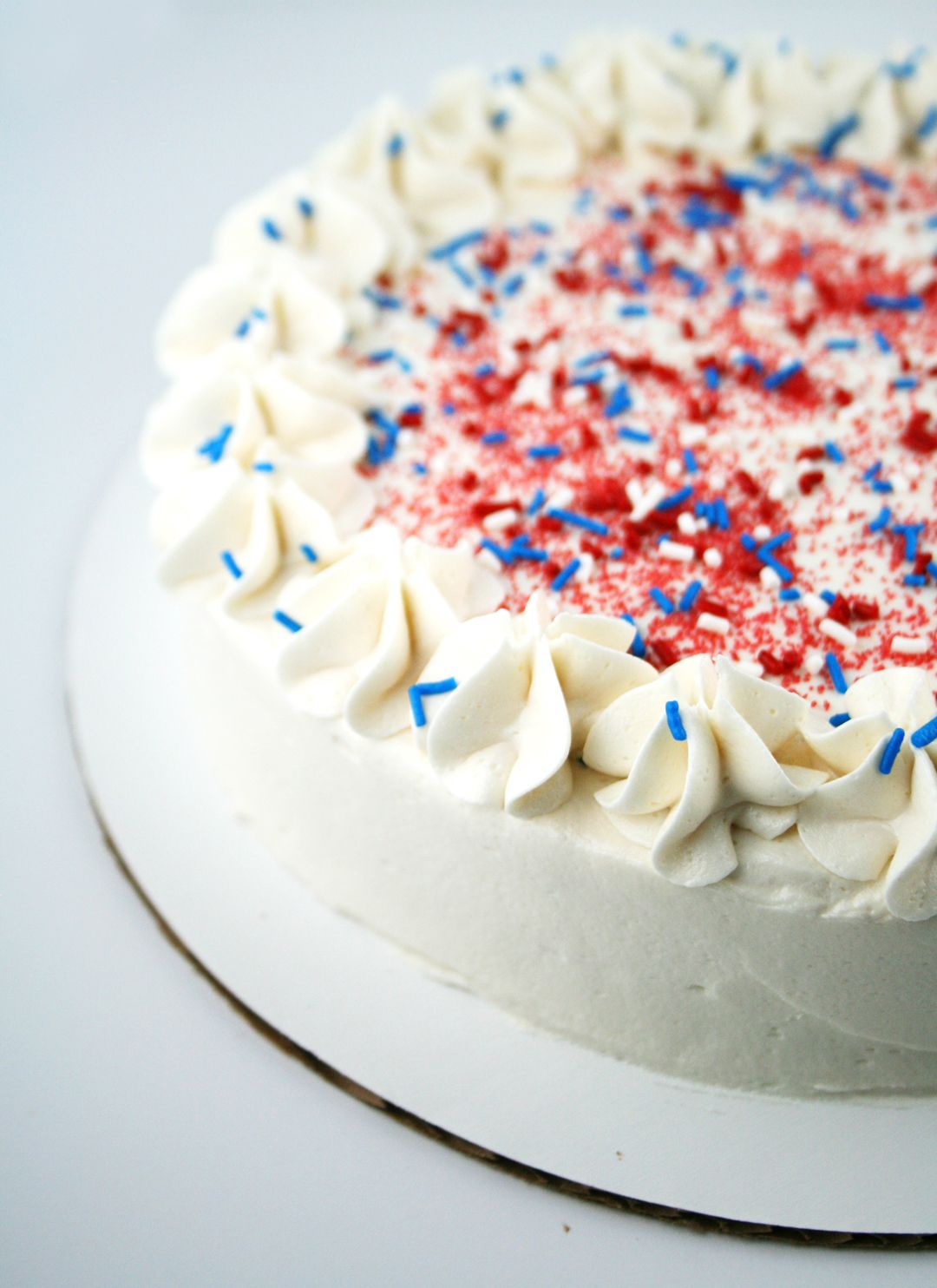 This patriotic red, white and blue tie dye cake is perfect for Memorial Day!