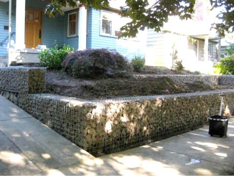 Gabion retaining wall front yard landscaping for Gabion landscaping