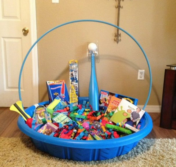 13 themed gift basket ideas for women men families themed gift easter basket using a baby pool and hula hoop to make one big easter basket instead of individual ones for each kid awesome idea negle Image collections