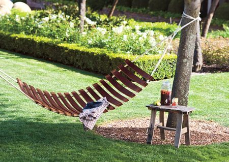 Repurposed old wine barrel into a hammock, could probably do this with any reclaimed wood