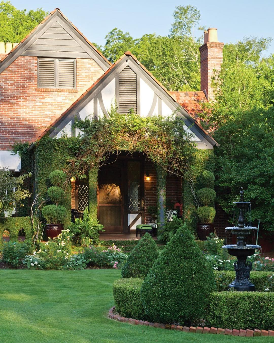 Step Inside This Lovely Colorful Cottage In Our July August Issue On Newsstands Now And Find Homeowner Mars Tudor Style Homes Tudor Cottage Cottage Exterior