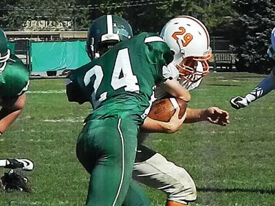 GAYLEN BLOSSER/Advocate photo Greenville's Alex Hoffman strips the ball from Trails running back sprinting 94-yards for a Wave touchdown.#advocate360