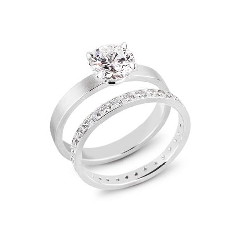 platinum four prong engagement ring set with a ct diamond shown with a platinum wedding band set with diamonds to the edge - Platinum Wedding Ring Sets