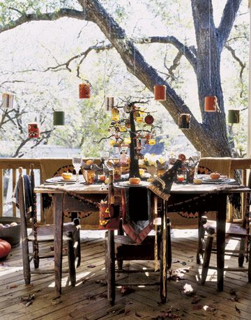 Shaded by a towering pecan tree, an upstairs porch is the site of numerous gatherings and meals under the stars, especially in autumn, when the weather is mild.