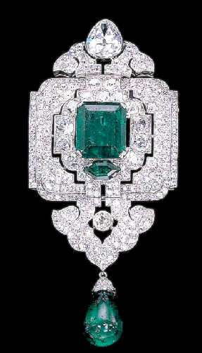 AN IMPRESSIVE EMERALD AND DIAMOND PENDANT/BROOCH, BY CARTIER  Designed as an old European and old mine-cut diamond openwork panel with a central rectangular-cut emerald weighing 12.28 carats, suspending a diamond palmette and emerald bead drop, to the pear-shaped diamond surmount, circa 1927, in its original Cartier red leather fitted case By Cartier